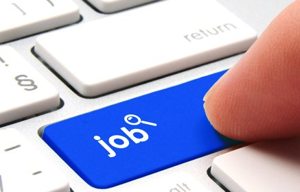 Finger on job search button on keyboard